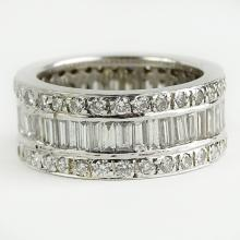 Lady's Approx. 3.0 Carat Round and Baguette Cut Diamond and 18 Karat White Gold Eternity Band. Diamonds F-G color, VS-SI clarity with a few I stones. Previously sized or repaired otherwise good condition. Ring size 6. Approx. weight: 5.75 pennyweights. Shipping $26.00