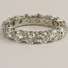 Lady's Approx. 4.25 carat Round Brilliant Cut Diamond and Platinum Eternity Band. Diamonds F-G color, VS1-SI1 clarity with a few SI2. Signed Plat. Very good condition. Ring size 6-1/2. Approx. weight: 3.90 pennyweights. Shipping $26.00