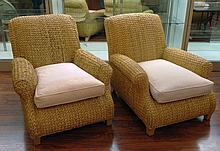 Pair of Oversize Ralph Lauren Woven Water Hyacinth Club Chairs with Upholstered Loose Seat Cushion. Signed. Minor Slices to Arms of One Chair, Minor Wear Consistent with Normal Use, Soiling to Fabric Otherwise Good Condition. Measure 35 Inches T