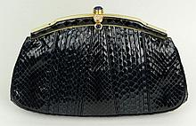 Judith Leiber Snakeskin Handbag with Gold Tone Hardware and Lapis Lazuli and Rose Quartz Clasp. Signed. Very Minor Wear Otherwise Good Condition or Better. Measures 5-1/4 Inches Tall and 8-1/4 Inches Wide. Shipping $38.00