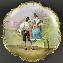 Late 19th to Early 20th Century Porcelain Charger, Possibly Limoges with Hand Painted Courting Couple Scene and Gilt C-Scroll Border. Artist Signed Armanto. Good Condition or Better. Measures 15-1/4 Inches Diameter. Shipping $56.00