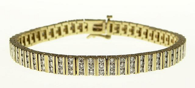 Lady's 14 Karat Yellow Gold and Channel Set Diamond Tennis Style Bracelet Set Throughout with 168 Round Diamonds Weighing Approximately 4.75 Carats of G-H Color and VS1-SI1 Clarity. Good to Very Good Condition. Weighs 24.0 Grams or 15.4 Pennyweights.