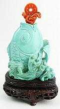 Vintage Chinese Carved Turquoise Spouting Fish Snuff Bottle on Hardwood Stand. Red Coral Stopper. Unsigned. Good Condition. Measures 2-1/4 Inches Tall. Shipping $28.00
