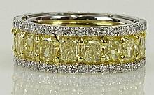 EGL certified 8.23 carat rectangular cut fancy intense yellow diamond, 1.64 carat round cut diamond and platinum eternity band. Yellow diamonds VS clarity. White diamonds E-F Color, VS1-Si1 clarity. Unsigned. Very good condition. Ring size 6-1/2.