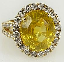 GIA certified 12.65 carat oval cut natural sapphire, 1.15 carat round cut diamond and 18 karat yellow gold ring. Sapphire with vivid saturation of color. Diamonds F-G color, VS clarity. Signed 18K. Very good condition. Ring size 7. Approx. weight: