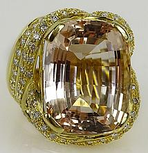 Lady's approx. 30.0 carat gem quality cushion cut kunzite, 2.50 carat round cut diamond and 18 karat yellow gold ring. Diamonds G-H Color, VS clarity. Signed 18K. Very good condition. Ring size 6-1/2. Approx. weight: 16.2 pennyweights. Shipping