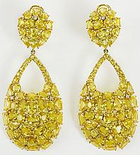 Pair of lady's fine quality approx. 48.0 carat mixed cut yellow sapphire. Yellow diamond and 18 karat yellow gold chandelier earrings. Sapphires with vivid saturation of color. Signed 18K. Very Good Condition. Measure 2-1/2 inches long and 1 inch