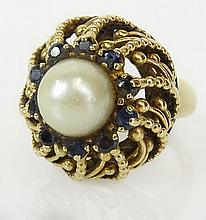 Lady's vintage 14 karat yellow gold, pearl and sapphire ring. Pearl measures 9mm. Signed 14K. Good condition. Ring size 6-1/2. Approx. weight: 7.7 pennyweights. Shipping $26.00