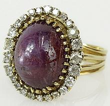 Lady's cabochon star ruby, diamond and 14 karat yellow gold ring. Ruby measures approx. 16mm x 12mm. Diamonds G-H color, VS-SI clarity. Signed 14K. Good condition. Ring size 8-1/2. Approx. weight: 8.3 pennyweights. Shipping $28.00