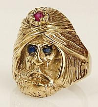 Vintage 14 karat yellow gold Arab man ring with ruby and sapphire accents. Signed 14K. Good condition or better. Ring size 8-1/4. Approx. weight: 6.5 pennyweights. Shipping $26.00