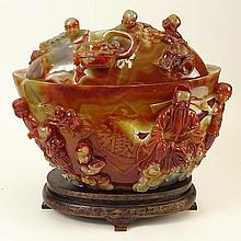 A Chinese Carnelian Agate Covered Bowl. Oval In Shape with Fine Figural Relief Carving. On Inlaid Silver Carved Wood Base. Unsigned. Good Condition. Measures 10 Inches Height, 12 Inches Width. Shipping $125.00