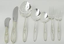 Thirty-one (31) piece Towle sterling silver partial flatware service including: six dinner forks; four salad forks; eight teaspoons; two soup spoons; six dinner knives; four butter knives and one slotted serving spoon. Signed. Good condition. Dinner