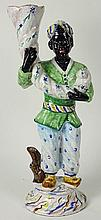 Vintage Terracotta Hand Painted Blackamoor Figure. Unsigned. Crazing or in Good Condition. Measures 20 Inches Tall. Shipping $95.00