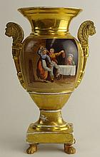 Old Paris Hand Painted Porcelain Bolted Urn. Panels Depicting Landscape and Dancers. Figural Lion's Head Handles (restored), Later Added Paw Feet. Wear and Restoration as mentioned. Unsigned. Measures 9-1/2 Inches Tall. Shipping $65.00
