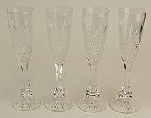 Four (4) Waterford Style Cut Crystal Champagne Flutes.  Very Good Condition. Measures 8-3/4 Inches Tall. Shipping $85.00