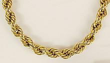 Lady's vintage 14 karat yellow gold rope necklace. Signed 14K. Good condition or better. Measures 18 inches long. Approx. weight: 21.3 pennyweights. Shipping $28.00