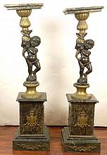 Pair Vintage Figural Cherub Bronze and Green Marble Pedestals. Each Features a Cherub embracing a Dolphin. Bronze Mountings. Unsigned. Dark Brown and Gold Patina. Wear and Rubbing or in otherwise good condition. Measures 48 Inches Tall, the tops 12