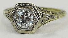 Lady's antique approx. .68 carat old European cut diamond, platinum and 14 karat gold ring. Diamond G-H color, SI1 clarity. Signed Plat and 14K. Good condition or better. Ring size 5-3/4. Approx. weight: 1.60 pennyweights. Shipping $26.00