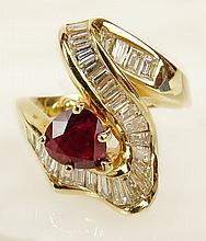 Lady's vintage pear shape ruby, baguette cut diamond and 18 karat yellow gold ring. Ruby with vivid saturation of color. Diamonds G-H color, VS-SI clarity. Unsigned. Tested 18K. Good condition. Ring size (with sizer balls) 3-1/2. Approx. weight: 4.60