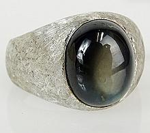 Men's vintage black star sapphire and 18 karat white gold ring. Sapphire measures 12mm x 10mm. Signed 750. Ring size 5-1/2. Approx. weight: 9.15 pennyweights. Shipping $26.00