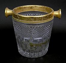 Heavy 20th Century Pattern Glass Champagne Bucket with Gilt Metal Fittings. Possibly French. Surface Wear and Scratches Consistent with Age Otherwise in Good Condition. Measure 8-1/2 Inches Tall by 7-1/2 Inches Diameter. Shipping $55.00