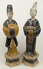 Pair of Chinese Tang Dynasty (AD 618-906) Glazed Pottery Tomb Figures with Nodding Heads, on Pedestal Bases. Surface Wear, Repairs and Chips Consistent with Age Otherwise in Good Condition. It has Been Suggested to the Gallery that this Item Was