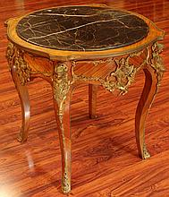20th Century Bronze Mounted Kingwood Center Table with Inset Marble Top above a Round Skirt with Floral Bronze Mounts and Childrens' Heads at the Corners, Supported by Four (4) Cabriole Legs with Bronze Mounts. Surface Wear and Scratches Consistent