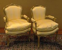 Pair Late 19th Century French Louis XV style Carved and Gilt Wood Fauteuils, Silk Upholstery. Unsigned. Minor Rubbing Consistent with Age and Normal Use Otherwise Good Condition. Measure 35 Inches Tall and 24 Inches Wide. We will not ship this item