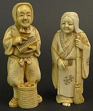 Two (2) Chinese Carved Ivory Male and Female Figures. Nicely Detailed. Signed with Chinese Characters on Base. Very Good Condition. One (1) Measures 4 Inches Tall by 1-1/2 inches Across and 1 Inch Wide. One (1) Measures 3-3/4 Inches Tall by 1-3/4