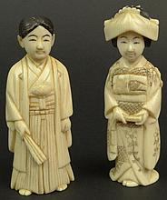 Pair of Chinese Carved Ivory Male and Female Figures. Nicely Detailed. Signed with Chinese Characters on Base. Very Good Condition. Each Measures 3-1/4 Inches Tall by 1-1/4 inches Across and 3/4 Inches Wide. This item will only be shipped
