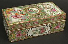 19th Century Chinese Porcelain Rose Medallion Covered Box. Finely Decorated with Court Scene, Butterflies, Birds and Flora. Inside Rim of Base has a Crack Otherwise in Good Condition. Measures 2-1/2 Inches Tall by 7 Inches Long and 3-3/4 Inches Wide.