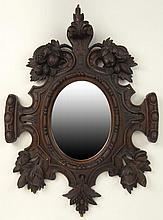 Late 19th Century Walnut Mirror with Relief Carved Fruit Motif. Unsigned. Minor Chips and Rubbing, Original Finish, Replaced Glass Otherwise Good Condition. Measures 20-3/4 Inches Tall and 15 Inches Wide. Shipping $56.00