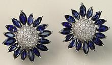 Beautiful Pair of Lady's 9.30 Carat Marquise Cut Sapphire, 1.60 Carat Round Brilliant Cut Diamond and 18 Karat White Gold Flower Ear Clips. Sapphires with Vivid Saturation of Color, VS Clarity. Diamonds E-F Color, VS Clarity. Signed 18K. Very Good