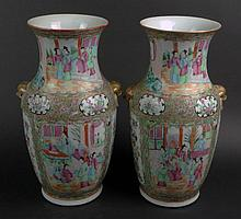 Pair of 19th Century Chinese Porcelain Rose Medallion Vases. Each Finely Decorated with Overall Court Scenes and Flora. Very Good Condition. Each Measures 14-1/2 inches Tall by 8-1/2 Inches Wide. Shipping $110.00