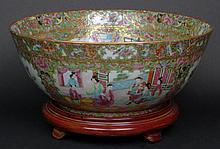 19th Century Chinese Porcelain Rose Medallion Punch Bowl. Finely Decorated with Court Scenes, Birds, Butterflies and Flora. Very Good Condition. Comes with a Hardwood Base. Measures 5-3/4 Inches Tall by 14-1/2 Inches Wide. Base Measures 2-1/4 Inches