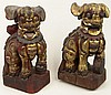 Pair of 19th Century Carved and Gilt Painted Wooden Foo Dogs. Each Carved from One Piece of Wood. Each Nicely Detailed in Colors of Gold, Red and Black. Mounted on Wood Bases. Surface Wear and Cracks Consistent with Age Otherwise in Good Condition.