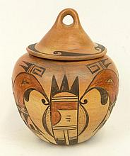 Vintage Native American Pottery Covered Jar with Stylized Figures. Unsigned. Rubbing Otherwise Good Condition. Measures 9 Inches Tall and 7 Inches Wide. Shipping $48.00