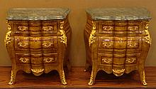 Matched Pair of Marble Top End Small Commodes Adorned with Cast Gilt Metal Mounts. Each with Shaped Marble Tops above Three (3) Serpentine Front Drawers and Bombe Shaped Sides. Veneer Losses Otherwise Good Condition. Each Measures 25-1/2 Inches Tall