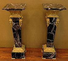 Matching Pair of Marble Pedestels. Each Nicely Mounted with Cast Metal Female Heads as well as Surrounds to the Top and Bottom. Very Good Condition. Each Measures 41-1/2 Inches Tall by 13-3/4 Inches Wide. We will not ship this item due to its size.