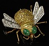 Lady's Vintage 14 Karat Yellow and White Gold, Round Cut Diamond and Cabachon Emerald Fly Brooch. Diamonds F-G Color, VS1-SI1 Clarity. Missing One Leg Otherwise Good Condition. Measures 1-1/4 Inches Long, 1-3/8 Inches Wide. Approx. Weight: 9.50
