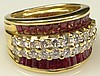 Lady's Levian Round Brilliant Cut Diamond, Tapered Baguette Cut Ruby and 18 Karat Yellow Gold Ring. Diamonds F-G Color, VS1-VS2 Clarity. Rubies with Vivid Saturation of Color. Signed. Good Condition or Better. Ring Size 7. Approx. Weight: 8.85