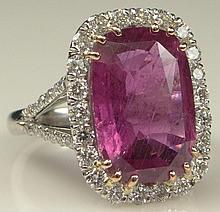 Very Fine Quality 7.40 Carat Cushion Cut Ruby, .90 carat Round Brilliant Cut Diamond and Platinum Ring. Ruby with Vivid Saturation of Color, Diamonds E-F Color, VS Clarity. Signed PT 800. Good to Very Good Condition. Ring Size 6-1/2. Approx. Weight: