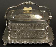 Antique English Cut Crystal and Silverplate Biscuit Box with Ivory Finial. Signed W&H; to Silverplate Base. Chips to Rim of Crystal and Surface Wear to Silverplate Consistent with Age and Normal Use Otherwise Good Condition. Measures 5-1/2 Inches