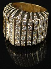 18 Karat Yellow Gold and Diamond Dinner Ring.  Approx. 4.50 Carats of Well Matched Channel Set Round Brilliant Diamonds of E-F Color and VS1-VS2 Clarity. Signed 18K. Size 7, Weighs Approx. 8.50 Pennyweights. Excellent Condition. Shipping $26.00