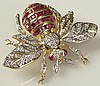 18K Yellow Gold, Ruby and Diamond Insect Brooch. This Lovely Brooch Accented Throughout with Round Brilliant Diamonds, Invisible Set Emerald Cut Rubies, as well as Ruby Cabochons. Signed 18K. Excellent Condition. Measures 1-1/2 Inches Length, 1-3/4