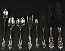 Fifty-Six (56) Piece Set Wallace Sterling Silver Flatware in the Sir Christopher Pattern. This Set includes: 14 Dessert Forks, 6-3/8 Inches; 4 Cocktail Forks, 5-1/2 Inches; 4 Butter Spreaders, 6-1/4 Inches; 6 Soup Spoons, 6 Inches; 17 Teaspoons, 6