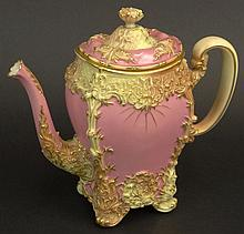 19th C Royal Worcester Porcelain Hand Painted Decorated Tea Pot. Pink Ground with Gilt Accents. Signed with Royal Worcester Back Stamp on Bottom and dots dating the Piece 1894. Light Wear to Gilt Décor. Measures 8-1/2 Inches Height. Shipping $68.00