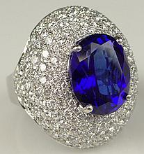 Impressive 18 Karat White Gold Tanzanite and Diamond Dome Cocktail Ring. The Center Stone a Tanzanite with Vivid Saturation of Color, Approx. 9.50 Carats, surrounded by Approx. 5 carats of round brilliant cut diamonds of D-E-F Color and VVS-VS1