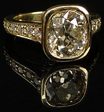 Fine Quality 3.34 Carat Old European Cushion Cut Diamond, .50 Carat Round Brilliant Cut Diamond and 18 Karat Yellow Gold Engagement Ring. Center Diamond J-K Color, SI1 Clarity. Signed 18K. Very Good Condition. Ring Size 6. Approx. Weight: 4.55