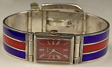 Rare Circa 1960's Gucci Lady's Enameled Sterling Silver Bracelet Watch. Signed. Minor Surface Wear from Normal Use Otherwise Good Condition. Case Measures 3/4 Inch Tall and 5/8 Inch Wide, Bracelet Measures 2-1/4 Inches Interior Diameter at Smallest